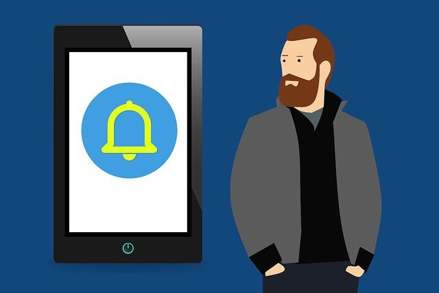 kreslený obrázek muže dívající se na telefon s upozorněním